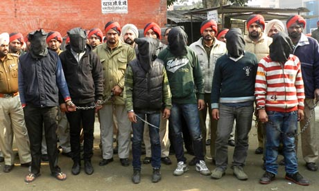 Indian police present six arrested men, accused of a gang rape in Punjab state.