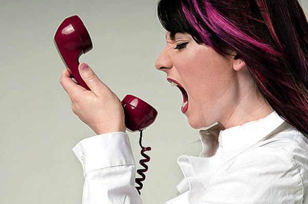 Woman-yelling-down-the-phone